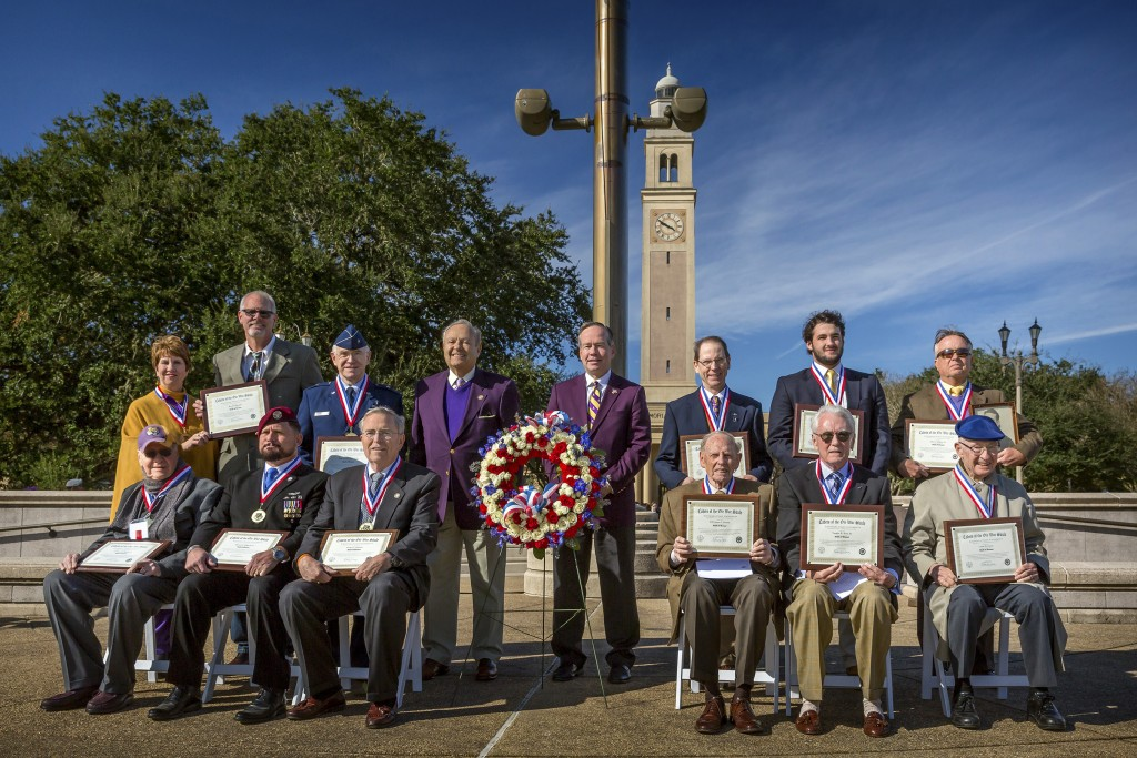Inducted into the military Hall of Honor during LSU Salutes activities Nov. 13-14  were, front, from left, William D. Shaffer Jr.; Daniel M. Waghelstein; Robert J. Barham; Frank Harrison, representing LTC  J. Logan Brown; Vaughn R. Ross Sr.; and Louis D. Curet; back, Debbie O'Shee and Ron Mitchell, representing their father, the late Roy D. Mitchell; Brig. Gen. Bobby V. Page; Cadets of the Ole War Skule President Richard Lipsey; LSU President King Alexander; James E. Gerace; Jack D. Hebert IV, representing his great-grandfather, the late Maxwell M. Merritt; and Timothy P. Killeen, representing his father, the late John J. Killeen Sr. LSU Salutes is sponsored annually by the university and Cadets of the Ole War Skule.